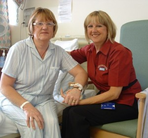 Hospital volunteer and Barnsley Breast Support Group organiser, Lynette Myatt speaks to a patient