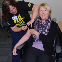 Non Executive Director Linda Christon receiving her flu jab