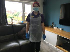 Helen wearing PPE in a home